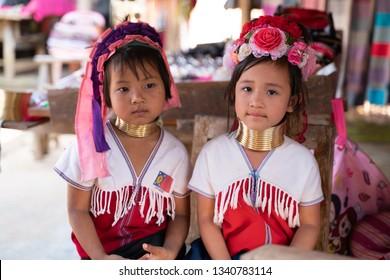 MAE HONG SON, THAILAND - FEBRUARY 6, 2019 : Karen little girl sitting at a local shop in northern Thailand.
