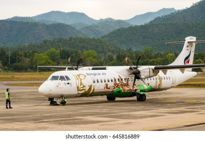 Mae Hong Son , THAILAND - January 11, 2017 ; ATR72-500 of Bangkok Airways Registered HS-PGK, Seen from the ground can see staff standby Checking airplane before next flight.