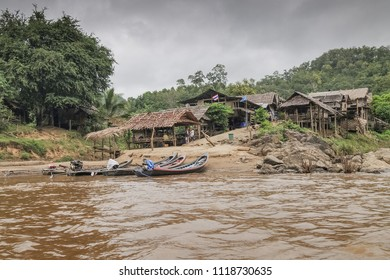Mae Hong Son -THAILAND, Nov. 9,2011 :   view morning of the huts with long-tail boat group floating in the river at Hui Pu Kaeng longneck village near by Thai-Myanmar border