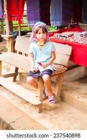 MAE HONG SON,  THAILAND - NOV 21, 2013: Unidentified Karen Long Neck girl in traditional hill tribe village also known as Kayan indigenous ethnic group