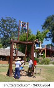 Mae Hong Son, Thailand - November 24, 2015: People playing on thailand traditional wooden swing at Suntichol village in Mae Hong Son, Thailand on November 24, 2015.