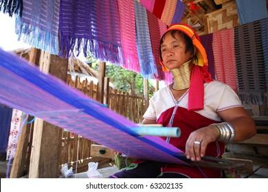 MAE HONG SON, THAILAND-APRIL 16: Long necked Karen women weaving show tourist in Huy Saur Tao village on 16 April, 2010 Mae Hong Son, Thailand