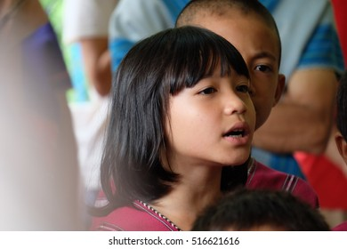 MAE HONG SON, THAILAND,AUGUST 10, 2016 : Karen hill tribe children  to prostrate their Mom on Thai Mother's day in the village of in Mae Hong ,August 10, 2016.