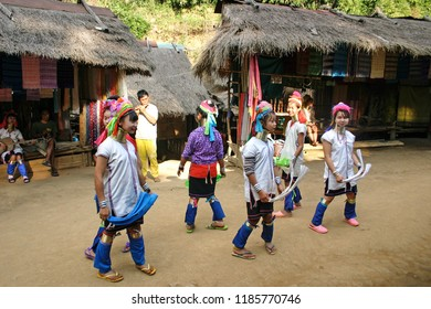 MAE HONG SON, THAILAND-JAN. 12, 2010:  Members of the Karen ethnic minority dance to music for passing tourists in a village outside of Chiang Rai.