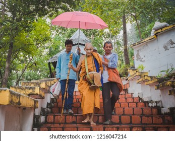 Mae Hong Son/Thailand-10.24.2018 : Venerable monk at Wat Phrathat doi Kongmu on The end of Buddhist lent day. In the morning, people give food offerings to a Buddhist monk.