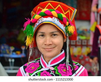 MAE SALONG, CHIANG RAI / THAILAND - NOV 10, 2015: Mature Yunnanese Sani Yi minority woman wears a traditional Sani Yi attire with traditional headdress and poses for the camera, on Nov 10, 2015.