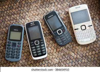MAE SOT, TAK, THAILAND - MARCH 02, 2016 : Keypad cell-phone brand Nokia placed on the background bamboo basketry at Mae Sot, Tak, Thailand. The keypad Nokia cell-phone was a very popular in Thailand.