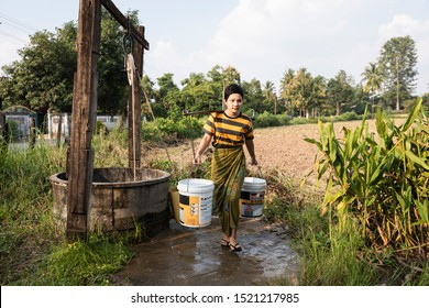 Mae Sot, Tak, Thailand - September 29, 2019 : Unidentified Myanmar woman live along the border is taking water from the pond for household use at Ban Tha Aad, Mae Sot, Tak, Thailand.