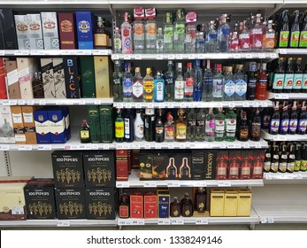 MAE SOT,TAK,THAILAND- MARCH 09, 2019: Shelf of Alcoholic beverages at TESCO LOTUS Super center. Sold to people aged over 18 Years old.Alcohol is a contention and crime.