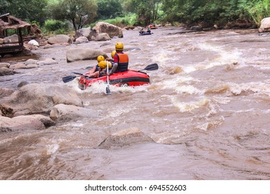 Mae Taeng,Chiang Mai/Thailand - August 3 Male and female tourists rafting at kued rive August 3,2017 Chiang Mai, Thailand