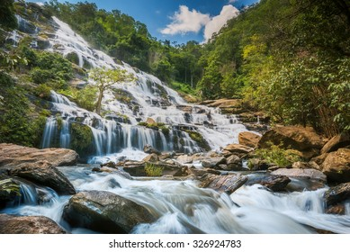 Mae Ya Waterfall is one of the most beautiful cascades in Doi Inthanon, Chiang Mai. Water flows from a 280-metre steep cliff onto different rock formations in a lower basin, creating a beautiful scene