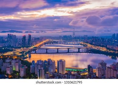 Maebongsan Mountain, Beautiful Sunrise over the Han River and Lotte Tower, viewed point from Maebongsan. 6 October 2018: Seoul South Korea.
