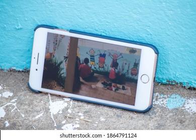 Maehongson School - 15 November 2020 : Smart phone with children screen on the ground.