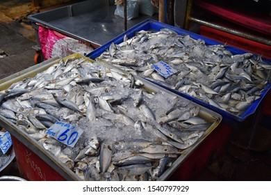 Maeklong railway street fish market by Bangkok Thailand. Street marine market where train passes daily. Sale of fresh fish. Freshly caught fish. Asian cuisine, Seafood, Fisherman. Catch. Fresh food. A