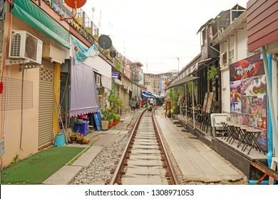 MaeKlong  Samut Songkhram Thailand -  December 9 2018 : MaeKlong market on the Railroad tracks or call Talat Rom Hup is unssen  of Samut Songkhram Thailand
