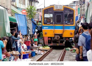 Maeklong, Thailand - March 17, 2017: The train passing through Maeklong Railway Market on March 17, 2017.