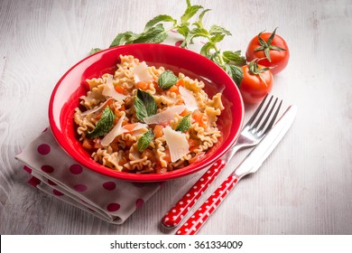 mafalda pasta with tomatoes mint and parmesan cheese flakes