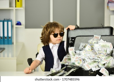 Mafia. Cute boy in sunglasses with a suitcase of money. Gambling. Gambling win. Children and cash. Financial education. Successful businessman during the financial crisis.