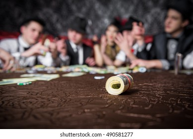 Mafia party in restaurant. Gangsters sitting at the table, party mafia. man and woman share the money won. Hand with cards. Hand with money