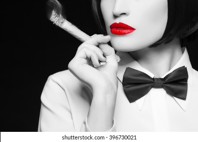 Mafia woman with cigar, red lips, selective coloring