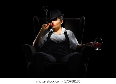 Mafiosi woman with cigar and brandy glass isolated