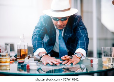 Mafioso man playing illegal poker.