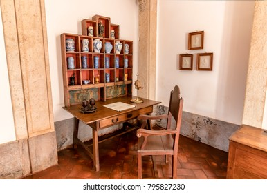 Mafra, Portugal - December 10, 2017:  Dispensary of 18th century with prescriptions and pots and other pharmaceutical objets inside Mafra National Palace, Convent and Basilica. Franciscan order
