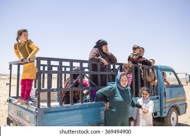 Mafraq, Jordan, 2015 June 14, Zaatari refugee camp in the Syrian people watching aid camp