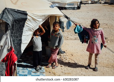 Mafraq, Jordan - June 2, 2014 : Children standing oustside in front of UNHCR tent at the Zaatari Refugee camp.