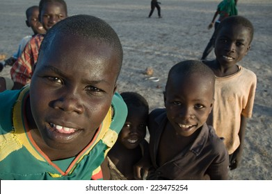 MAGA,CAMEROON- CIRCA MAY , 2008 -  Children with dirty shirts from small village north of Cameroon standing in front of camera lens.