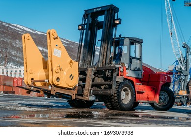 Magadan, Russia - April 03, 2019.  Commercial Seaport.  There is an unloading of equipment for gold mining. These are loaders, excavators, bulldozers.