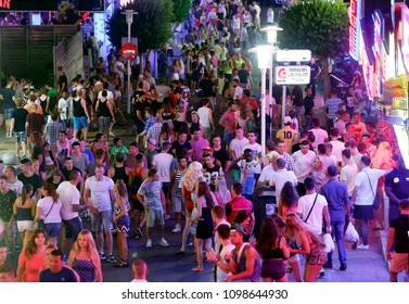 Magaluf, Mallorca / Spain - June 13, 2015: British tourists enjoy nightlife at punta ballena street in magaluf on the Spanish island of Mallorca, one of main destinations for UK tourism during summer.