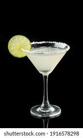 Magarita cocktail with lemon and salt on black background, item drink for bar menu