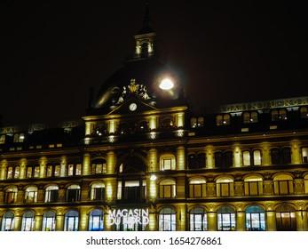 Magasin du Nord building in Copenhagen illuminated during a winter night
