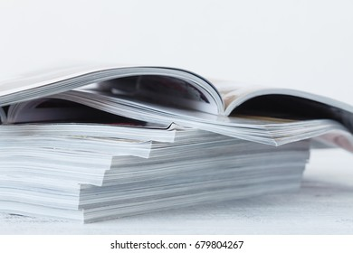 Magazine blur on a wooden table.