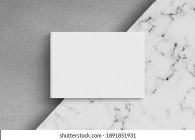 Magazine or catalog on white marble table