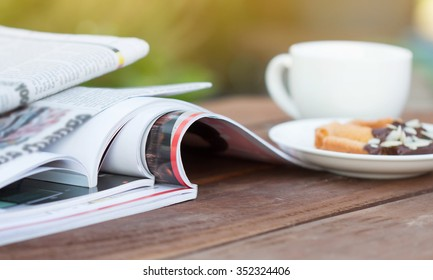 Magazine on a wooden table.
