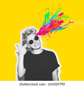 Magazine style collage of headshot portrait rocky emotional woman blow mind with finger gun gesture, brain explosion of colors. Mind brain blowing concept. Fun fashion blonde girl in rock sunglasses.
