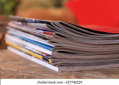 Magazines on the wooden table