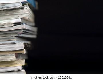Magazines Stack. Black background.