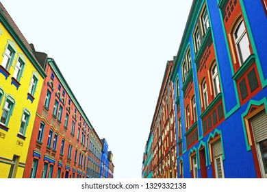 Magdeburg, Germandy - 02/28/2019: Otto-Richter-Street with multi colored painted houses in Magdeburg, Germany, designed by Carl Krayl and Bruno Taut in 1921