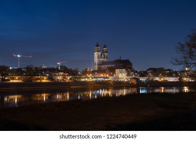 Magdeburg, Germany - 4 November 2018: Night view of the cathedral and the river Elbe in Magdeburg, Germany.