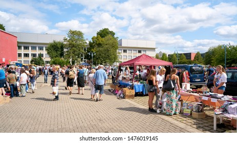 MAGDEBURG, GERMANY – AUGUST 04, 2019: Visitors on a popular flea market in downtown Magdeburg on a Sunday