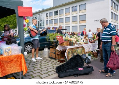 MAGDEBURG, GERMANY – AUGUST 04, 2019: Musician on a popular flea market in downtown Magdeburg on a Sunday