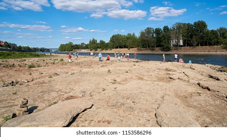 MAGDEBURG, GERMANY – AUGUST 05, 2018: People on the cathedral-Rock on the river Elbe in Magdeburg. The cathedral-Rock is visible only in great drought.