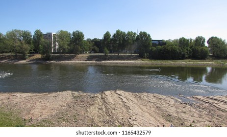 Magdeburg, Germany - August 10, 2018: View of the dry riverbed of the Elbe in Magdeburg, drought, Climate change