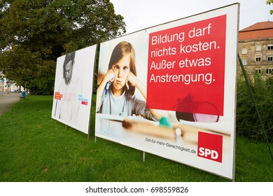 MAGDEBURG, GERMANY – AUGUST 18, 2017: Election campaign posters of different parties, for the Bundestag election on 24 September 2017 in the city center of Magdeburg