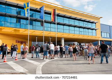 MAGDEBURG, GERMANY – AUGUST 31, 2017: Visitors in front of the new Ikea branch in Magdeburg, just a few minutes before the opening.