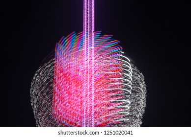 Magdeburg, Germany - December 2, 2018: Nightly view of an 80 meter high chain carousel at the Christmas market in Magdeburg, Germany. Long-term exposure, abstract.