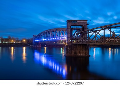 Magdeburg, Germany - December 4, 2019: View of the illuminated old railway bridge Hubbrücke in Magdeburg, Germany.